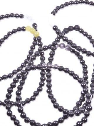 bracciale elasticizzato ematite naturale nera con 3 sfere pietre dure