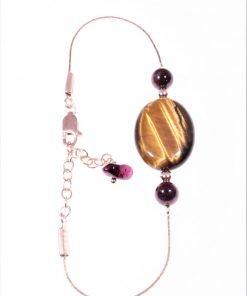 Bracciale occhio di tigre argento rosa, granati .Bracciale con catenina in argento rosa con al centro occhio di tigre ovale e 2 sfere di granato.
