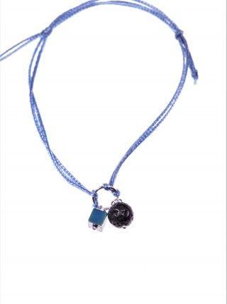 Bracciale cordino blu, lava Bracciale con doppio cordino colore blu, centrale anellino argento con sfera lava e cubo ematite S/S-19 summer