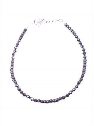 Bracciale minimal, ematite argento Collezioni: mini-stone Bracciale semi rigido ematite naturale rondelle e sfere sfaccettate, argento rodiato nero.